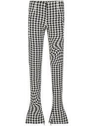 psychedelic houndstooth-print trousers